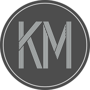 "Capital ""KM"" in a circle"