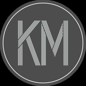 "Capital ""KM"" in a circle"